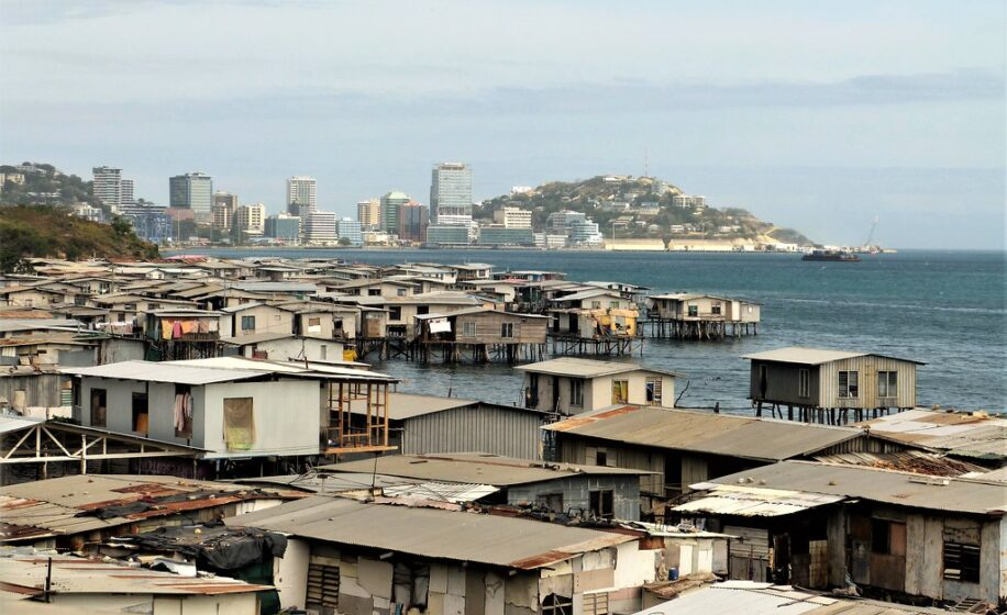 """""""Stilt Houses Port Moresby"""" by gailhampshire is licensed under CC BY 2.0. To view a copy of this license, visit https://creativecommons.org/licenses/by/2.0/"""